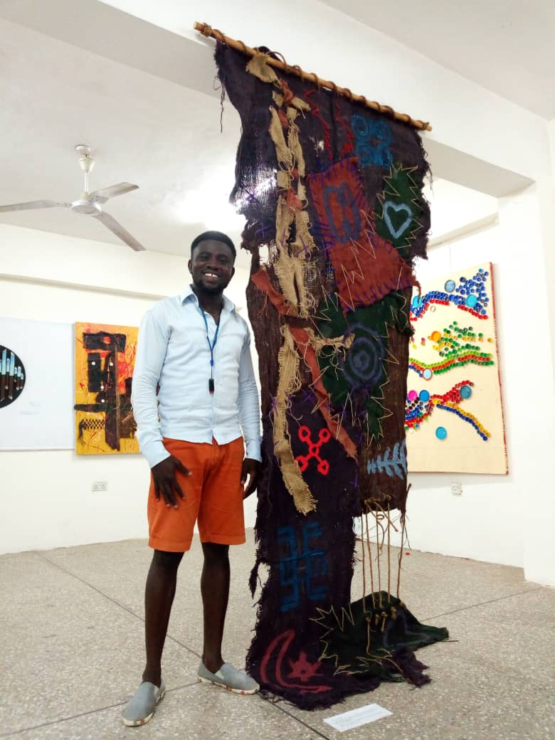 Osei Moses Seth with one of his artworks